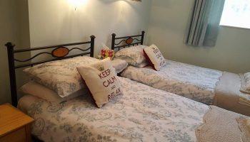 white guest house keep calm