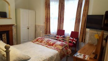 white guest house double room